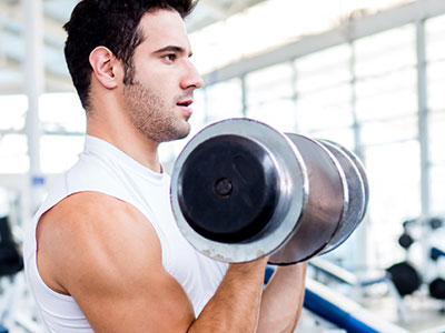 man working on hypertrophy with bicep curls
