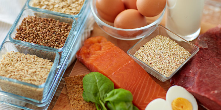 Salmon, eggs, and grains on table
