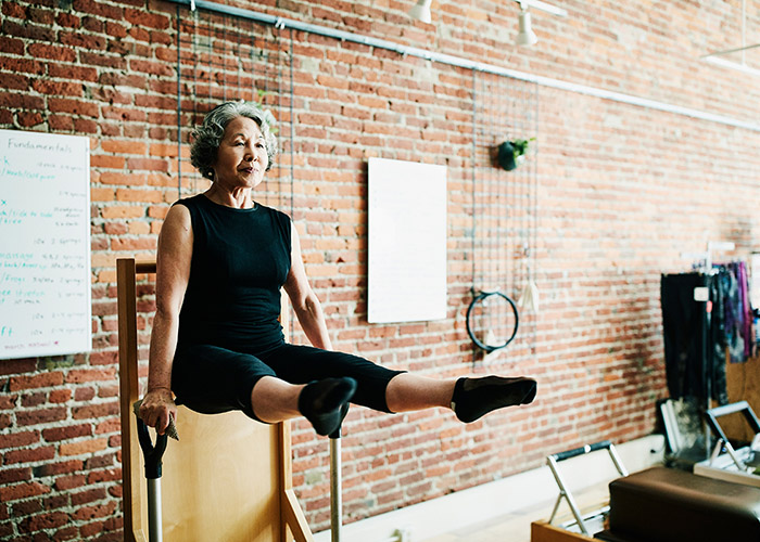 older woman doing a v-sit